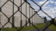 A view of the Kingston Penitentiary in Kingston, Ont. The federal government has announced the closure of Canada's oldest prison as part of a cost-cutting move. (Lars Hagberg/LARS HAGBERG/THE CANADIAN PRESS)