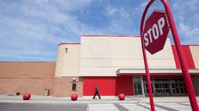 People walk passed a closed Target store location on Barton Street East in Hamilton on April 30, 2015. Executives at major landlords Ivanhoé Cambridge and Oxford Properties Group – which bought back 11 Target store leases for $138-million – said they see the mass retail exit as an opportunity to replace Target and others with stronger retailers. (Glenn Lowson For The Globe and Mail)