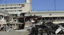 Debris outside Elliot Lake's Algo Centre Mall. Two women died in the mall's collapse in June. (Fred Lum/The Globe and Mail)