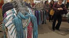 Shoppers look over the clothes at the Vermont Trading Company in Montpelier, Vt., in this file photo. (Toby Talbot/AP Photo)