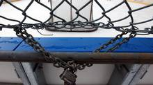 In this file photo a chain and pad-lock are seen at a hockey rink in Toronto (Tim Fraser/The Globe and Mail)