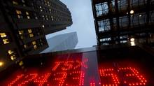 A tote board displays the closing figure for the TSX for the year in Toronto on Dec.31, 2012. (FRANK GUNN/THE CANADIAN PRESS)
