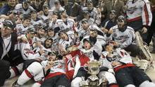 The Windsor Spitfires pose for a team picture after defeating the Kelowna Rockets 4-1 to win the Memorial Cup. (Ryan Remiorz)