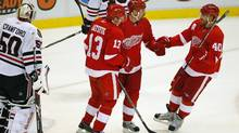 Tomas Holmstrom #96 of the Detroit Red Wings celebrates a first period goal with Pavel Datsyuk and Henrik Zetterberg #40 during a pre season game on September 24, 2010 at Joe Louis Arena in Detroit, Michigan. (Photo by Gregory Shamus/Getty Images) (Gregory Shamus/2010 Getty Images)