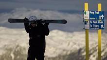 A Whistler Blackcomb employee makes his way to work atop Whistler mountain Feb. 1, 2011. (JOHN LEHMANN/JOHN LEHMANN/THE GLOBE AND MAIL)