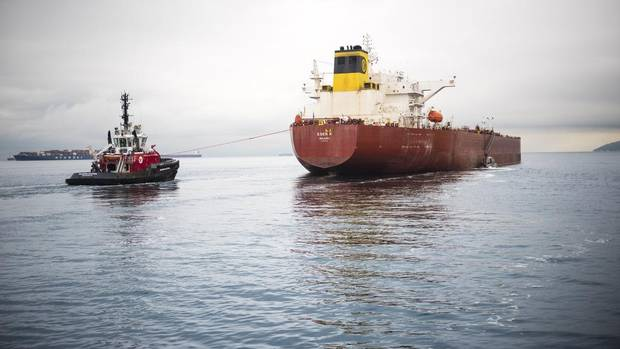 A SeaSpan tugboat escorts an oil tanker carrying oil from the Kinder Morgan pipeline.