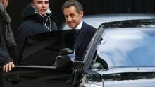 """Former French President Nicolas Sarkozy enters a car as he leaves his residence in Paris on March 25, 2013. Sarkozy was placed under formal investigation on Thursday for """"abuse of weakness"""" in a 2007 party funding case involving elderly L'Oreal heiress Liliane Bettencourt, the public prosecutor said. (CHARLES PLATIAU/REUTERS)"""