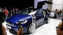 A Tesla Model X is displayed on media day at the Paris auto show Sept. 30. (Benoit Tessier/Reuters)