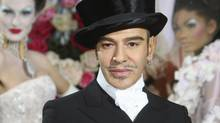 Christian Dior said Tuesday, March 1, 2011, that Galliano has been immediately laid off, just days after he was suspended as its creative director pending an investigation into an alleged anti-Semitic incident in a Paris cafe last week. (Jacques Brinon/AP/Jacques Brinon/AP)