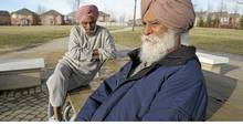 Kanga Sadhu and Joginder Pooni chat about politics in a gazebo in Brampton, Ont., April 12, 2011. (J.P. MOCZULSKI/J.P. MOCZULSKI For The Globe and Mail)