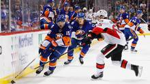 Cal Clutterbuck (15) of the New York Islanders skates against Erik Karlsson (65) of the Ottawa Senators during their game at the Barclays Center on March 23, 2016 in New York City. (Al Bello/Getty Images)