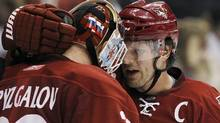 Phoenix Coyotes' Shane Doan, right, celebrates a win over the San Jose Sharks with teammate Ilya Bryzgalov (30), of Russia, after the third period of an NHL hockey game Friday, April 8, 2011, in Glendale, Ariz. The Coyotes defeated the Sharks 4-3, and with the win clinched a playoff spot. (AP Photo/Ross D. Franklin) (Ross D. Franklin)