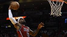 Miami Heat's LeBron James dunks (RHONA WISE/REUTERS)