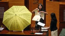 Lawmaker Leung Kwok-hung rips up a prop representing a Hong Kong electoral reform proposal during an oath-taking ceremony in the chamber of the Legislative Council in Hong Kong, China, on Oct. 12, 2016. (Anthony Kwan/Bloomberg)