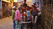Through interviews with a cross-section of Delhiites, Dasgupta reports on wealth inequality. (Anindito Mukherjee/REUTERS)