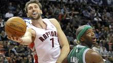 Toronto Raptors forward Andrea Bargnani puts up a shot against Boston Celtics forward Jermaine O'Neal (R) during the first half of their pre-season NBA basketball game in Toronto December 18, 2011. REUTERS/Mike Cassese (MIKE CASSESE)