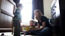 Amy Beeman reads with her 18-month old twin son and daughter, Sam(left) and Lucy(right), at their home in Vancouver, British Columbia, Wednesday, Feb. 8, 2012. (Rafal Gerszak for The Globe and Mail/Rafal Gerszak for The Globe and Mail)