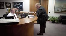 Mayor Rob Ford talks with his executive assistant, Tom Beyer, at City Hall on Nov 6, 2013. (MOE DOIRON/THE GLOBE AND MAIL)