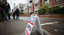 People pass an open house sign in Vancouver, British Columbia, in Oct., 2012. (Rafal Gerszak For The Globe and Mail)