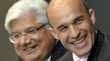 Michael Lazaridis, President and co-chief executive officer and co-founder, left, and Jim Balsillie, co-chief executive officer receive applause as they take their seats at the start of the Blackberry maker's AGM in Waterloo, July 12, 2011. (J.P. MOCZULSKI For The Globe and Mail)