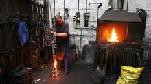 Peter Trick strikes a heated clapper in orger to make it shorter works at the Whitechapel Bell Foundry. (Jim Ross/The Globe and Mail/Jim Ross/The Globe and Mail)