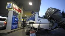 A driver fills up at a Toronto gas station (Fred Lum/Fred Lum/The Globe and Mail)