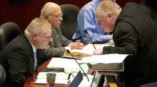 Councillor Doug Ford, left, and his brother, Mayor Rob Ford, speak during a council meeting at Toronto City Hall on Nov. 13, 2013. (KEVIN VAN PAASSEN/THE GLOBE AND MAIL)