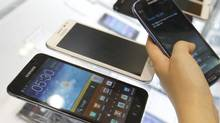 The CRTC announced on Thursday, Oct. 11, 2012, that it plans to end complicated contract language used by Canada's wireless carriers. (LEE JAE-WON/REUTERS)
