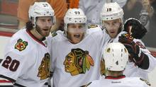 Members of the Chicago Blackhawks celebrate Jonathan Toews's goal against the Anaheim Ducks during the first period in Game 7 of the Western Conference final Saturday, May 30, 2015. (Mark J. Terrill/AP)