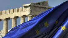 Columns of the Parthenon are seen behind an European Union flag in Athens on Nov. 4, 2011. (LOUISA GOULIAMAKI/AFP/Getty Images)