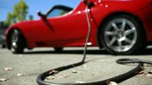 A Tesla Roadster is electrically charged at Tesla Motors Inc. in San Carlos, Calif. (ROBERT GALBRAITH/REUTERS)