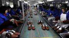 Employees work at a shoe factory in Lishui, Zhejiang province, Jan. 24, 2013. (LANG LANG/REUTERS)
