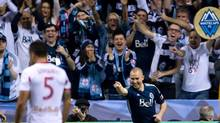 Vancouver Whitecaps' Kenny Miller, right, of Scotland, celebrates after scoring his second goal as New York Red Bulls' Armando, of Spain, looks on during second half MLS action in Vancouver, B.C., on Saturday March 8, 2014. (DARRYL DYCK/THE CANADIAN PRESS)