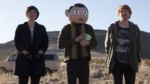 "Maggie Gyllenhaal, Michael Fassbender (centre) and Domhnall Gleeson in a scene from ""Frank,"" opening in Toronto and Vancouver Friday. (THE CANADIAN PRESS)"