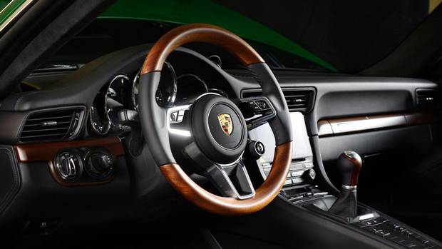 The steering wheel and shift knob are clad in mahogany.