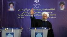 Iranian President Hassan Rouhani waves after casting his vote during elections for the parliament and Assembly of Experts, which has the power to appoint and dismiss the supreme leader, in Tehran in this February 26, 2016 file photo. (HANDOUT/REUTERS)