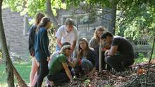 Carolyn Eyles, in green, director of the integrated science program at McMaster University in Hamilton, takes a soil sample with her students from a ravine on campus. The iSci program often takes students outside the classroom to study and problem solve within several science fields, including geology, etymology and botany, and has been recognized as a innovative undergrad program. (Glenn Lowson For The Globe and Mail)