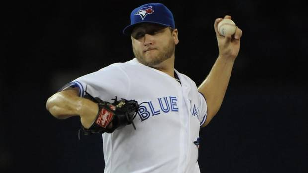 Toronto Blue Jays' Mark Buehrle pitches against the Kansas City Royals' during first inning MLB baseball game action Friday August 30, 2013 in Toronto. (JON BLACKER/THE CANADIAN PRESS)