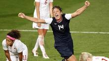 Abby Wambach, who scored the winning goal against Canada at the London Games last August, is thrilled that the Olympics pumped up Canadian Christine Sinclair's status and their rivalry so significantly. Canada plays the United States in Toronto on Sunday. (ANDREA COMAS/REUTERS)