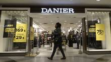 A woman walks past a Danier store in Montreal, Thursday, Feb.4, 2016. Danier Leather Inc. said it has entered insolvency proceedings in order to protect itself from creditor lawsuits as it seeks a buyer.THE CANADIAN PRESS/Ryan Remiorz