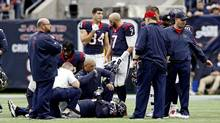 Houston Texans tackle Duane Brown is examined by team medical staff after being injured during the first half against the Jacksonville Jaguars at NRG Stadium in Houston, Texas, U.S. January 3, 2016. A new Harvard University study says third-party doctors are needed (instead of doctors under contract with teams) to better assess if players are able to return to play after injury. (Kevin Jairaj/USA Today Sports)