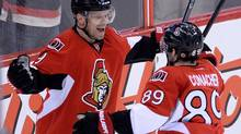 Ottawa Senators' Milan Michalek, left, celebrates a first period goal with teammate Cory Conacher against the Winnipeg Jets' during NHL action in Ottawa on Thursday, Jan. 2, 2014. (Sean Kilpatrick/THE CANADIAN PRESS)
