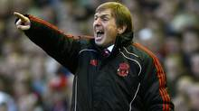 Liverpool manager Kenny Dalglish, left, reacts during their English Premier League soccer match against Wigan Athletic at Anfield, Liverpool, England, Saturday Feb. 12, 2011. The two teams tied 1-1. (AP Photo/Tim Hales) (Tim Hales)