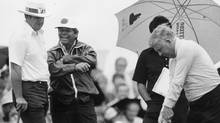 J.C. Snead (left) and Lee Trevino share a laugh as they watch old friend Moe Norman (right) hit a few balls at the 1982 Canadian Open.