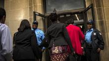 Workers walk into the General Services Administration building in downtown Washington, hours after the president signed a bill to reopen the federal government and raise the debt limit, October 17, 2013. (James Lawler Duggan/Reuters)