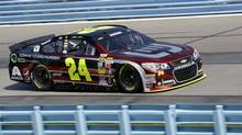Jeff Gordon (24) drives during a qualifying session for Sunday's NASCAR Sprint Cup Series auto race at Watkins Glen International on Aug. 9 in Watkins Glen N.Y. (Mel Evans/AP)
