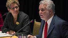 Ontario Premier Kathleen Wynne and Quebec Premier Philippe Couillard chair a joint cabinet meeting at the Ontario Legislature in Toronto on Friday, November 21, 2014. (Chris Young/THE CANADIAN PRESS)