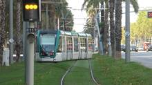 A Tram Barcelona LRT leaves the Francesc Macia terminus, en route to Llevant-Les Planes, on October 10, 2013 (Oliver Moore/The Globe and Mail)