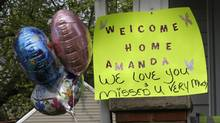 A sign hangs on the porch of the home of Amanda Berry on Wednesday in Cleveland. (Tony Dejak/AP)