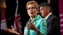 Ontario Premier Kathleen Wynne and Finance Minister Charles Sousa in Toronto on Tuesday. The lack of co-operation between the federal and Ontario governments means that vital tax changes to accommodate the ORPP aren't being made. (Aaron Vincent Elkaim/THE CANADIAN PRESS)